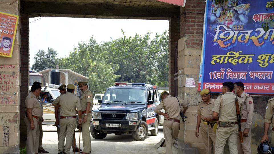 Police personnel on guard, at Dasna, in Ghaziabad,  on Sunday, September 15, 2019, following clashes between members of two castes.