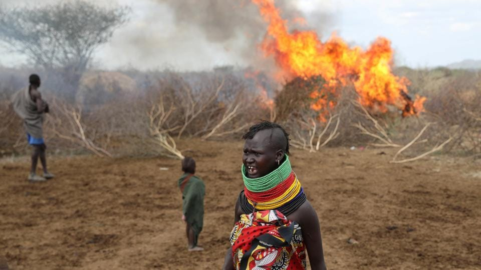A Turkana tribeswoman reacts after an accidental fire at a shelter in Turkana settlement in Ilemi Triangle, Kenya. First, the scouts saw a footprint, then a suspected spy from a rival ethnic group, scuttling off into the bush. Expecting an attack, young men grabbed their guns and mothers grabbed their children - there are few state security forces in this remote area of northern Kenya. (Goran Tomasevic / REUTERS)