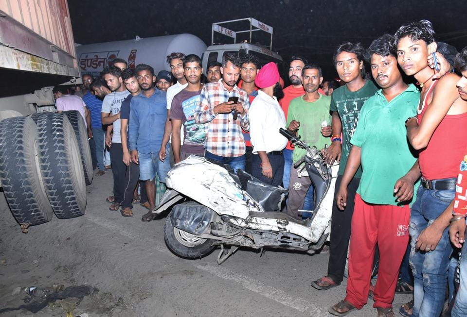 Locals gathered at the spot where the man and his daughter were crushed under a truck at Kailash Chowk on Sunday night.