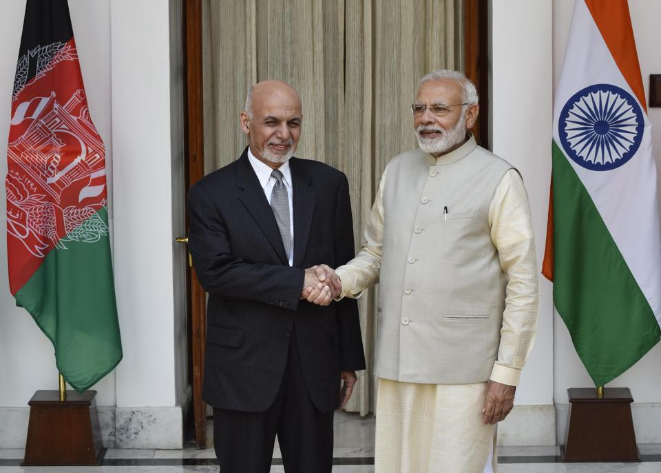 Prime Minister Narendra Modi and Afghanistan President Ashraf Ghani. Without putting boots on the ground, India must play a much bigger role in Afghanistan, including to safeguard the multibillion-dollar assistance it has provided that country, and to checkmate Pakistan