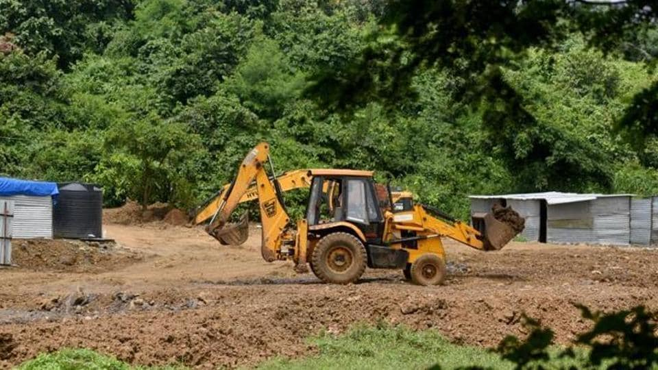 Trenches dug and land leveled using mud for construction of car shed near unit 19 Aarey for Metro III project.