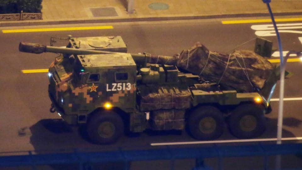A military vehicle travels along a road as streets in Central Beijing were closed for a rehearsal of the military parade on October 1 to mark the 70th anniversary of the founding of the People's Republic of China in Beijing.