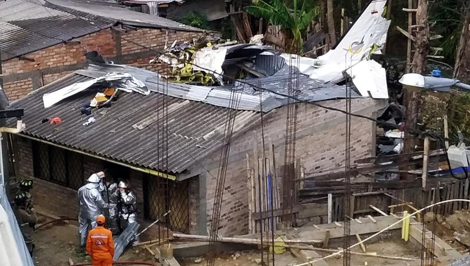 Rescue crews work in the wreckage from a plane that crashed into a house in Popayan, Colombia September 15, 2019.
