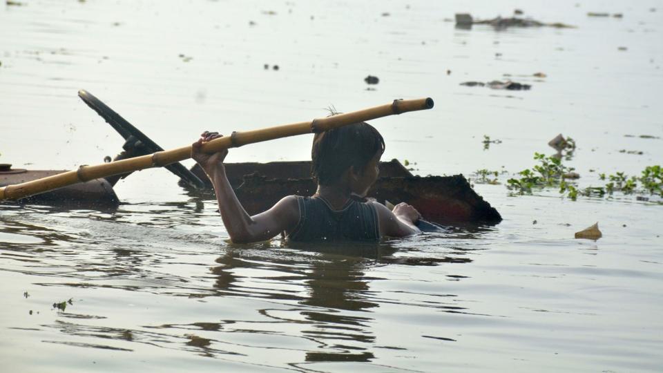 A child wades through flood water in a low-lying area of Prayagraj, Uttar Pradesh.