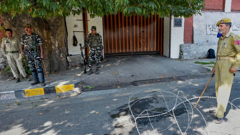 Police and CRPF personnel stand guard near the residence of National Conference President Farooq Abdullah, in Srinagar, Monday, Sept. 16, 2019.
