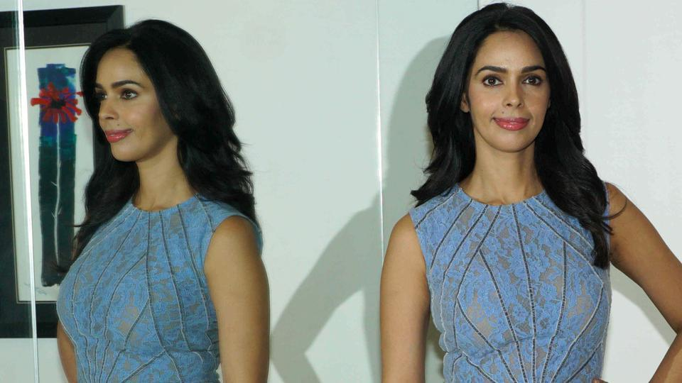 Mallika Sherawat poses during a press conference.