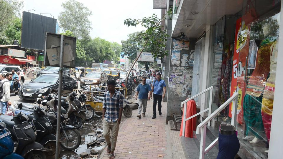 Vehicles parked on MG road, Camp in Pune.