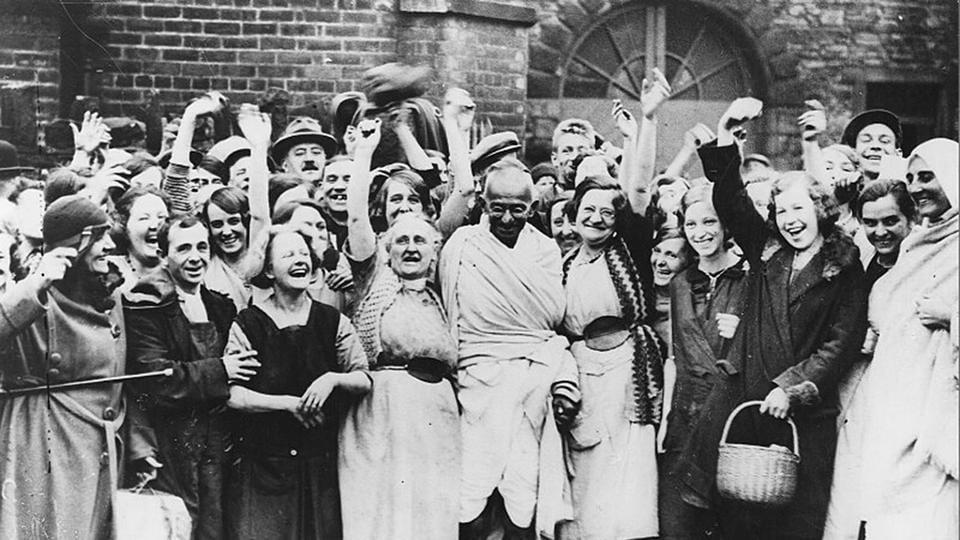 Gandhi in Lancashire, January 1, 1931: Indian nationalist leader Mahatma Gandhi (Mohandas Karamchand Gandhi, 1869 – 1948) is greeted by a crowd of female textile workers during a visit to Darwen, Lancashire. Courtesy National Gandhi Museum.
