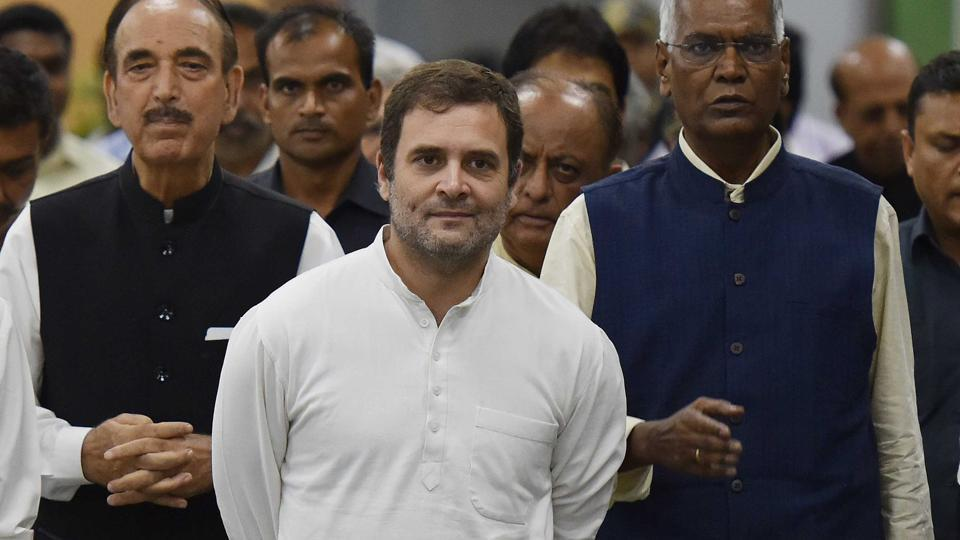 Congress leader Rahul Gandhi (center) took to Twitter to comment on Home Minister Amit Shah's comments, raising Hindi to a common language.