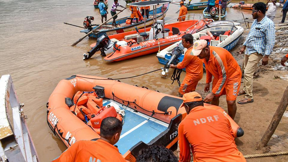 NDRF personnel carry out rescue operations after a tourist boat capsized in the swollen Godavari river in East Godavari district of Andhra Pradesh.