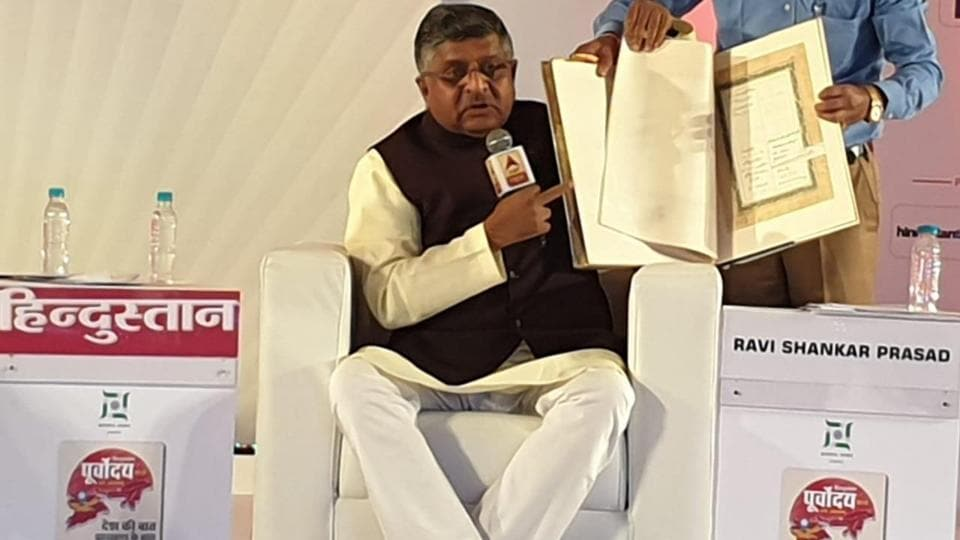 Union minister Ravi Shankar Prasad holds a copy of the original Constitution carrying paintings of Indian gods and rulers. He was speaking at HindustanPurvoday summit in Ranchi, Jharkhand