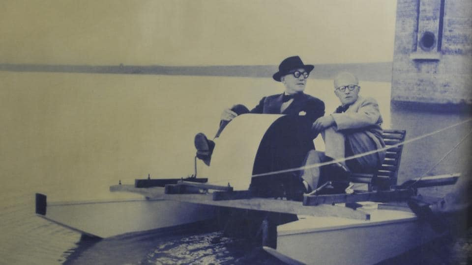 An old picture of Le Corbusier and Pierre Jeanneret in a wooden boat at Sukhna Lake in Chandigarh.