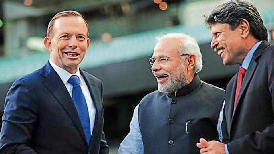 File picture from 2014 shows Prime Minister Narendra Modi meeting his Aussie counterpart Tony Abbott with Kapil Dev