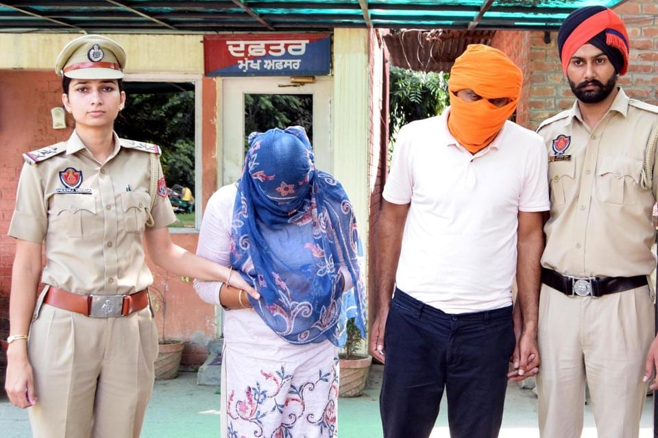 Paramjit Kaur and Harvinder Singh in the Mohali police custody on Tuesday. They were arrested on the complaint of a woman residing in Chajjumajra, who alleged she was duped of ₹40 lakh.