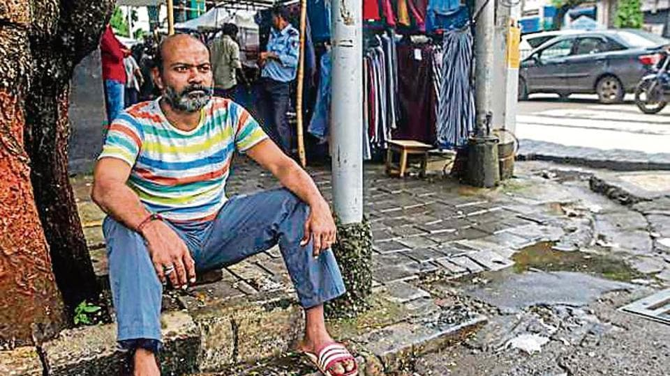 Uday Konar sits at his hawking space in Colaba. His father used to run a newspaper stall at the spot since 1960s