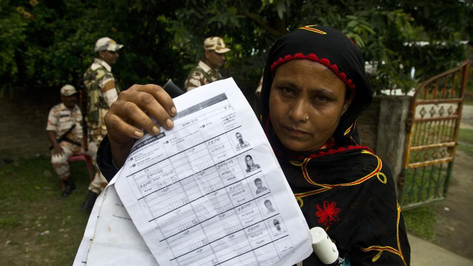 A woman displays a document that shows inclusion of her name in the final list of the National Register of Citizens (NRC) in Pabhokati village in Assam's  Morigaon district .