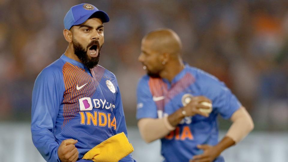 Virat Kohli celebrates the wicket of South African batsman Quinton de Kock.