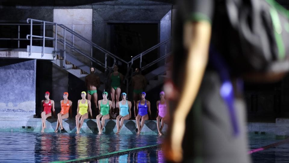 Models wear creations as part of the Benetton Spring-Summer 2020 collection, unveiled during the fashion week, in Milan.