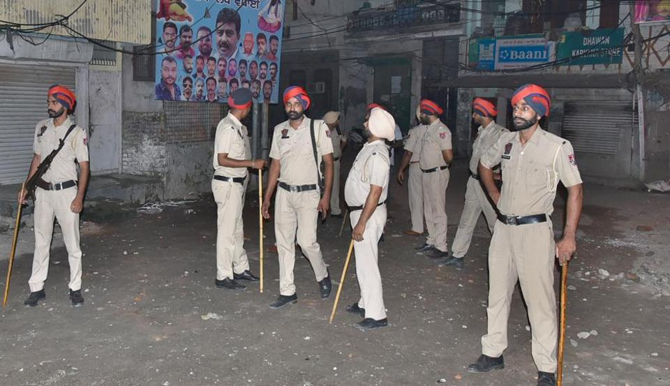Police personnel at the site after a clash in Chhawani Mohalla, Ludhiana, on Wednesday.