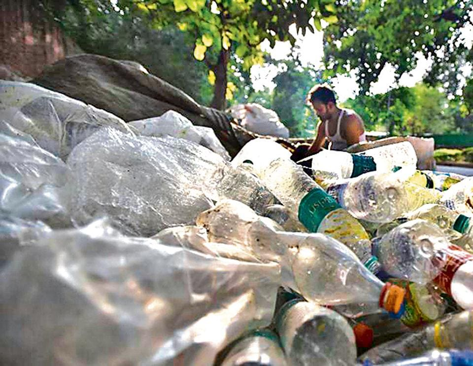 A scrap vendor sorts plastic at Mandi House in New Delhi. The Delhi govt is planning to ban some single-use plastic items in the national capital, after Prime Minister Narendra Modi pitched for India doing away with single-use plastic. While there's no official definition of 'single-use plastic', it largely refers to plastic bags, cups, water bottles, wrappers, sachets and straws that are said to contribute significantly to river and soil pollution. (Raj K Raj / HT Photo)