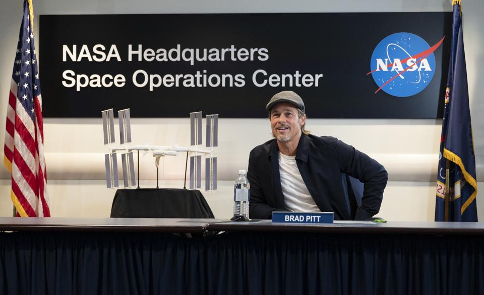 Brad Pitt speaks with NASA astronaut Nick Hague who is on board the International Space Station.