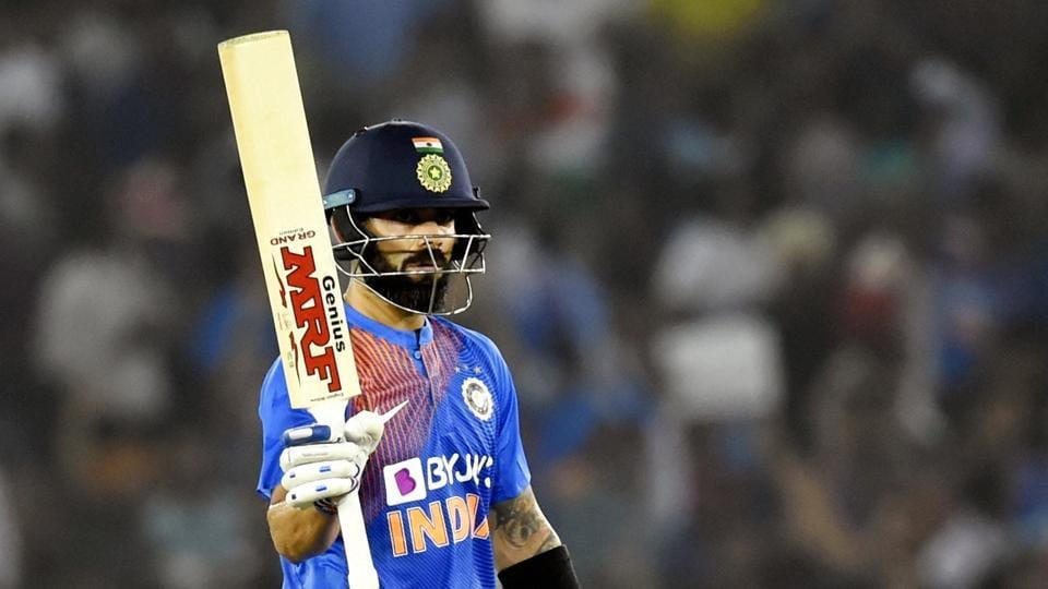 Indian captain Virat Kohli raises his bat after scoring fifty runs during 2nd T20I between India and South Africa at Mohali, Wednesday, Sept. 18, 2019.