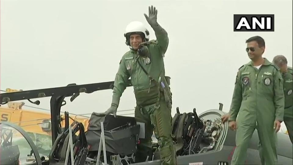 Rajnath Singh preparing to fly on 'Tejas', an Indigenous Light Combat Aircraft from Bengaluru's HAL Airport. (ANI Photo)