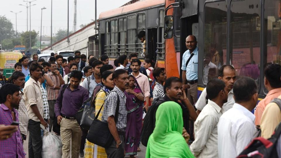 Daily commuters are seen during a strike by United Front of Transport Association (UFTA) against various provisions of the amended Motor Vehicle (MV) Act, in New Delhi.
