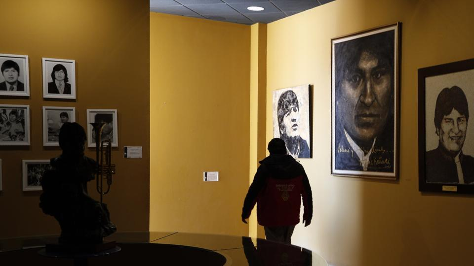 In this Sept. 13, 2019 photo, photos of Bolivia's President Eva Morales adorn the walls at the Democratic and Cultural Revolution Museum in Orinoca, Bolivia. The museum in a remote town high up in the deserts of the Bolivian altiplano was built by President Morales in his birthplace of Orinoca to honor the country's indigenous peoples. (AP Photo/Juan Karita)