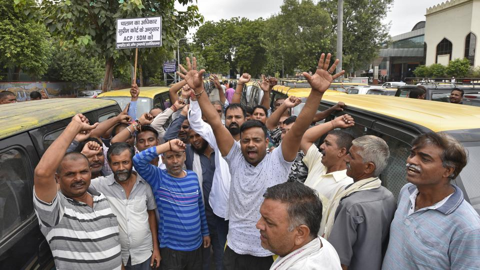 Taxi drivers shout slogans against central and Delhi government during a strike call by United Front of Transport Associations against the hefty penalities for road traffic violations under the amended Motor Vehicles Act, at Nizamuddin Railway Station, in New Delhi, India, on Thursday, September 19, 2019.