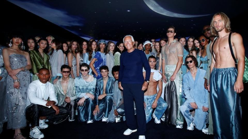 Italian fashion designer Giorgio Armani poses with models after a presentation from the Emporio Armani Spring/Summer 2020 collection during fashion week in Milan, Italy, September 19, 2019. REUTERS/Alessandro Garofalo