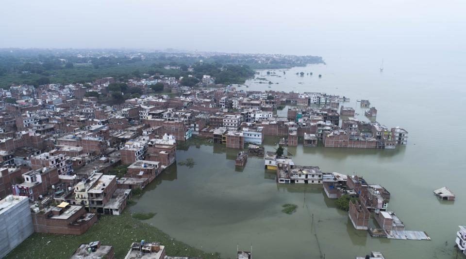 Prayagraj: A view of buildings at Chhota Boghara area submerged in flooded water of River Ganga following heavy rain, at Salori area in Prayagraj (Allahabad) ,