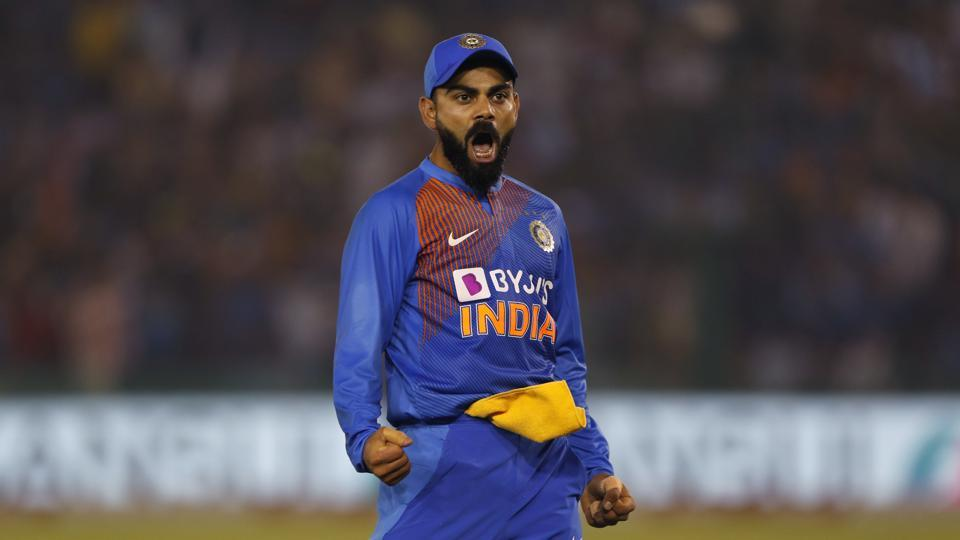 India's captain Virat Kohli reacts after taking a catch to dismiss South Africa's captain Quinton de Kock during the second T20 international match between India and South Africa, in Mohali, India, Wednesday.