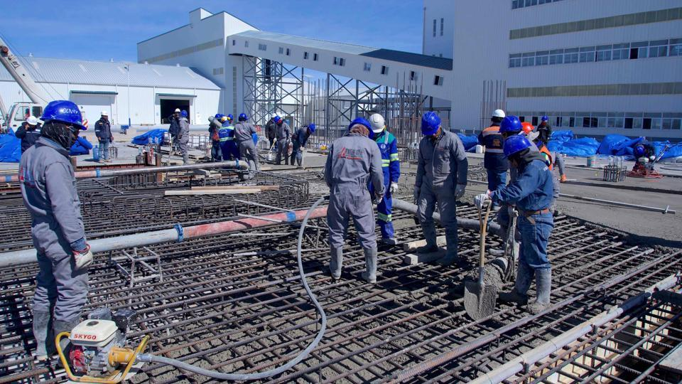 Construction workers pour concrete on the foundations of the new state-owned lithium extraction complex. State company Yacimientos de Litio Bolivianos (YLB), established by the government of President Evo Morales in 2008 to exploit lithium in the salt flats, aims to make Bolivia the fourth-largest producer by 2021. Morales is counting on lithium to serve as the economic engine that lifts his country out of poverty. (Pablo Cozzaglio / AFP)