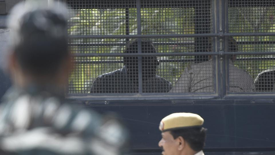 Former Finance Minister P Chidambaram is seen sitting inside a Police van as he was brought in for INX Media case hearing, at Rouse Avenue District Court, in New Delhi.