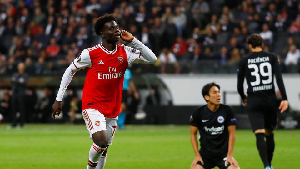 Arsenal's Bukayo Saka celebrates scoring their second goal