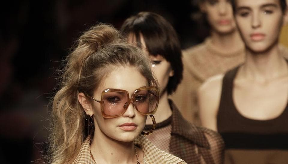 Model Gigi Hadid wears a creation as part of the Fendi Spring-Summer 2020 collection, unveiled during the fashion week, in Milan, Italy, Thursday, Sept. 19, 2019. (AP Photo/Luca Bruno)