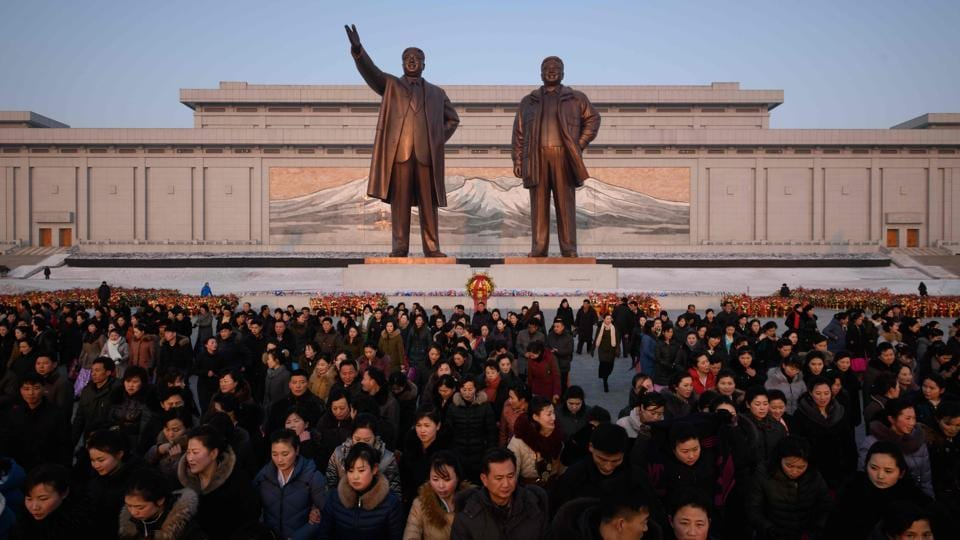 "An image of Mount Paektu displayed behind the statues ofKim Il Sung and Kim Jong Il, as people pay their respects in Pyongyang. ""The guerrilla fighters shed tears from pity that our general -- only a few months old -- had so little to eat and brought back food and goat milk."" The story has several echoes of the Christian Nativity, from a bright star shining in the sky, a birth in adversity, and well-wishers bringing gifts. (Ed Jones / AFP)"
