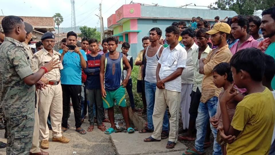Police team collects details after a septuagenarian was beaten to death on suspicion of being child lifter in remote Kucha Pahari area under Mirzachoki police station in Sahebganj district.