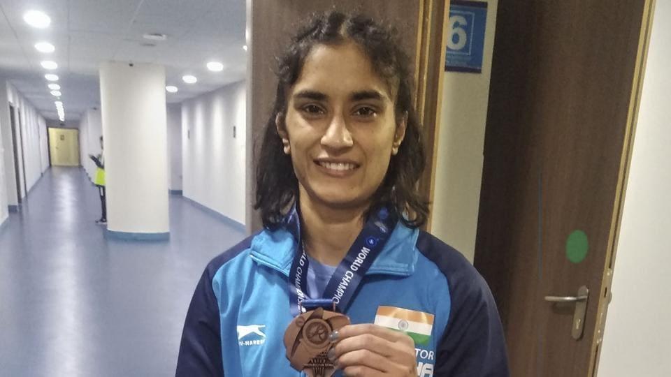 Vinesh Phogat shows her bronze medal at the Wrestling World Championships in Nur-Sultan, Kazakhstan.