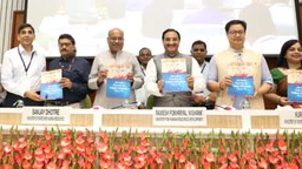 HRD minister Ramesh Pokhriyal Nishank releasing the AISHE 2018-19 report. (Photo @DrRPNishank)