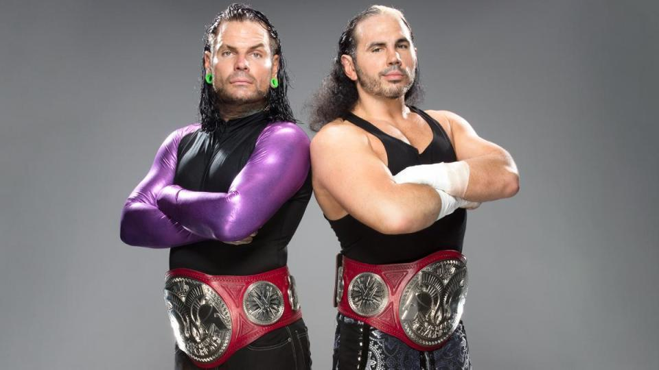 Jeff Hardy and Matt Hardy with the tag team titles.