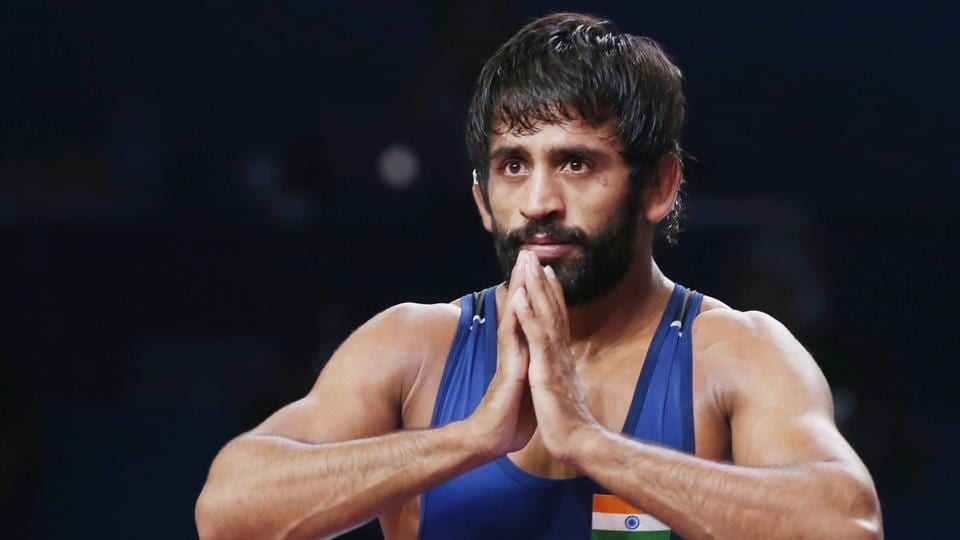 Bajrang Punia of India reacts as he won the bronze match of the men's 65kg category.