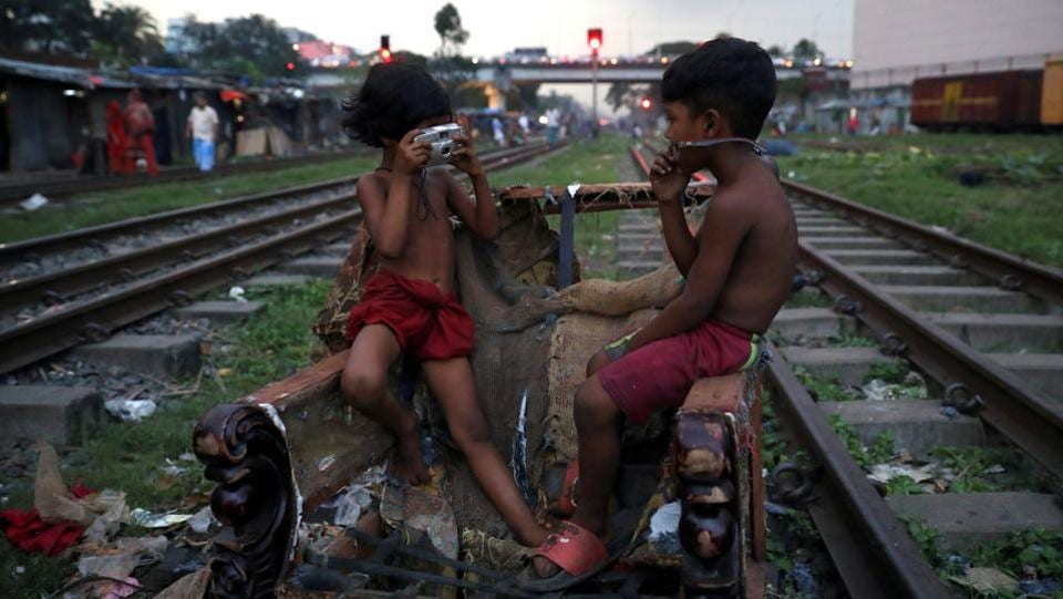 Children act out taking pictures with a non-functioning camera in Dhaka, Bangladesh. (Mohammad Ponir Hossain / REUTERS)