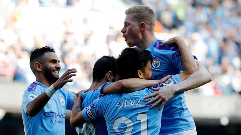 Manchester City's Bernardo Silva celebrates scoring their sixth goal with teammates.