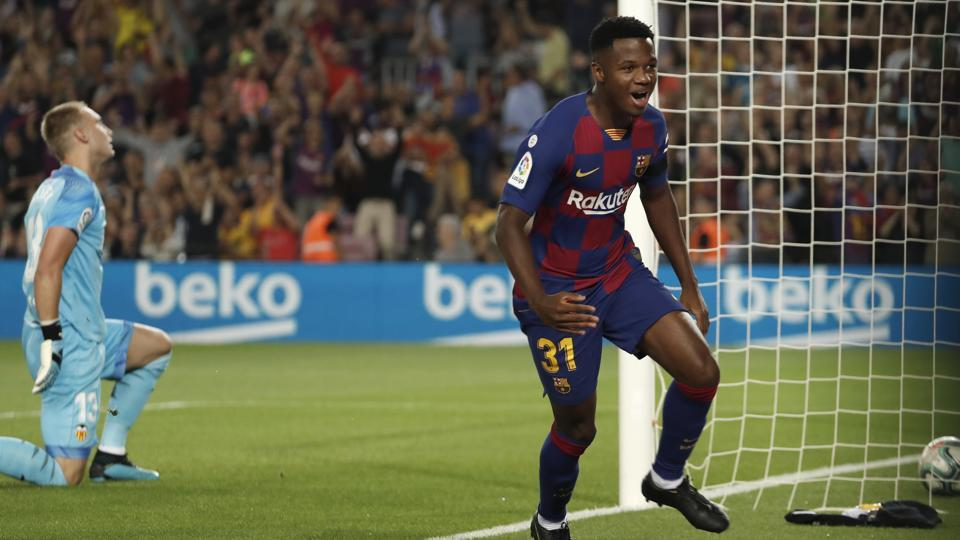 Ansu Fati celebrates after scoring the opening goal for Barcelona against Valencia.