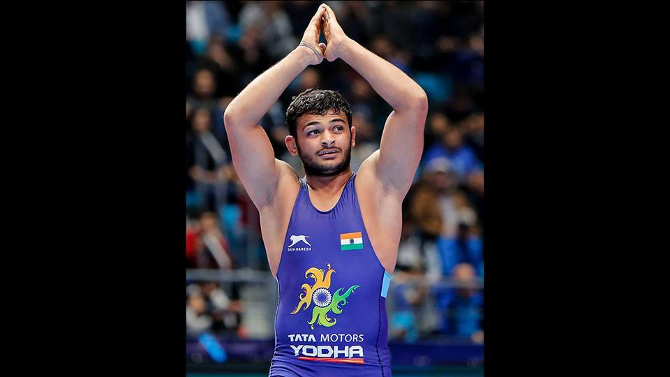 Reigning junior world champion Deepak Punia (86kg) acknowledges his supporters after defeating Switzerland's Stefan Reichmuth in the semifinals of World Wrestling Championship 2019, in Nur-Sultan, Kazakhstan. (PTI)