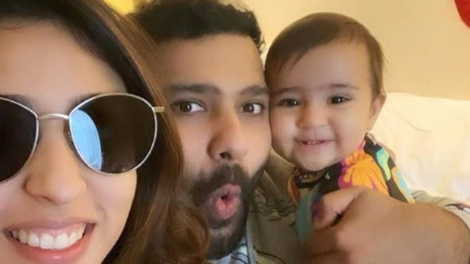 Rohit Sharma (middle) poses along with his family.