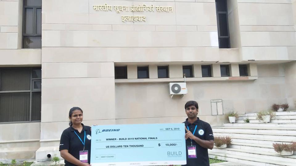 Pawan Kumar and Shefali Vinod Ramteke with their cheque won at BUILD-2019.