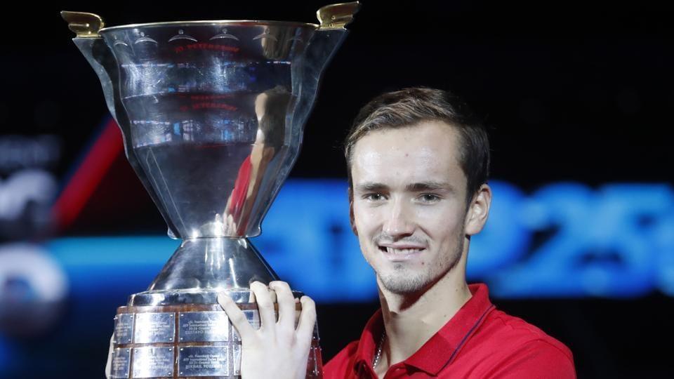 Daniil Medvedev holds the trophy after winning the St. Petersburg Open ATP tennis tournament.